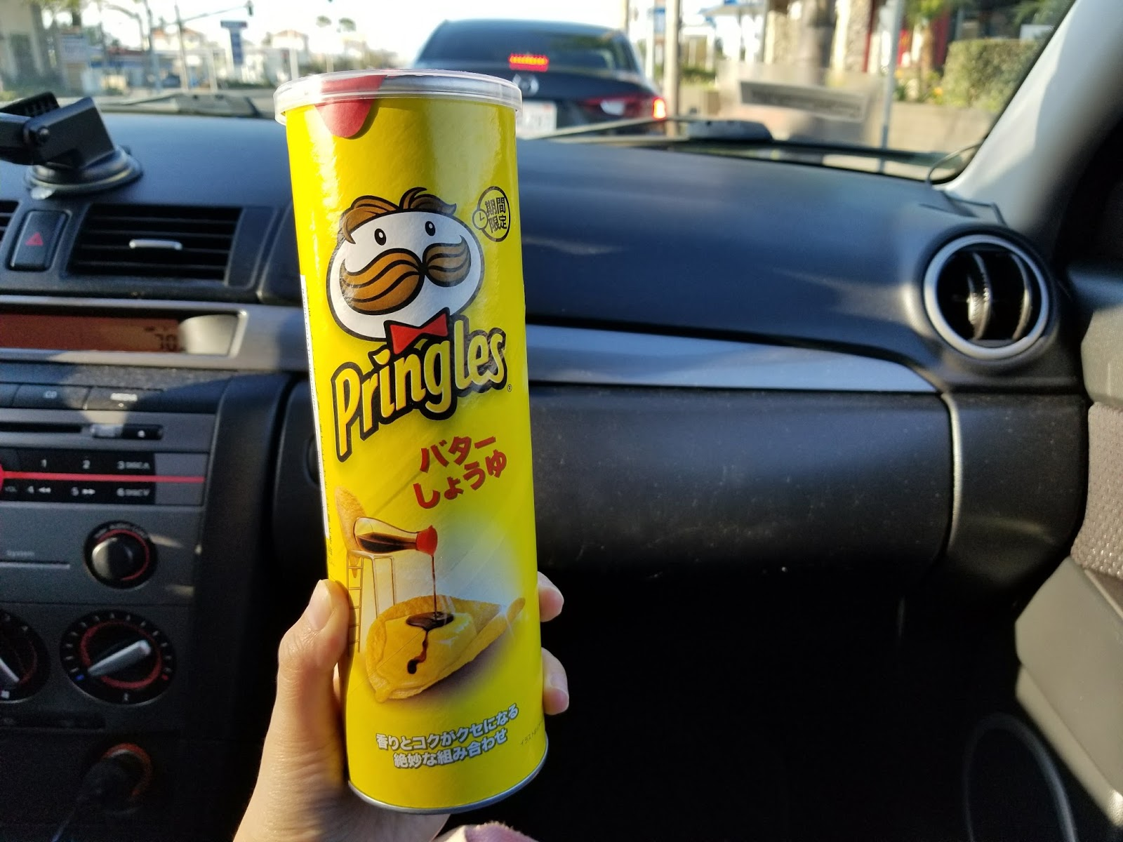 Munching on Japanese Pringles Butter Soy Sauce Chips!