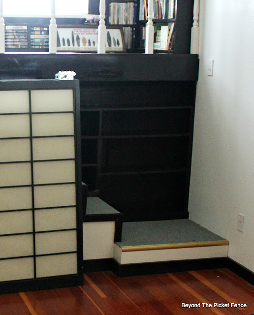 before picture of a built in bookshelf