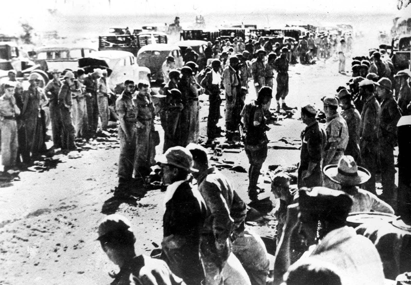 American soldiers line up as they surrender their arms to the Japanese at the naval base of Mariveles on Bataan Peninsula in the Philippines in April of 1942.