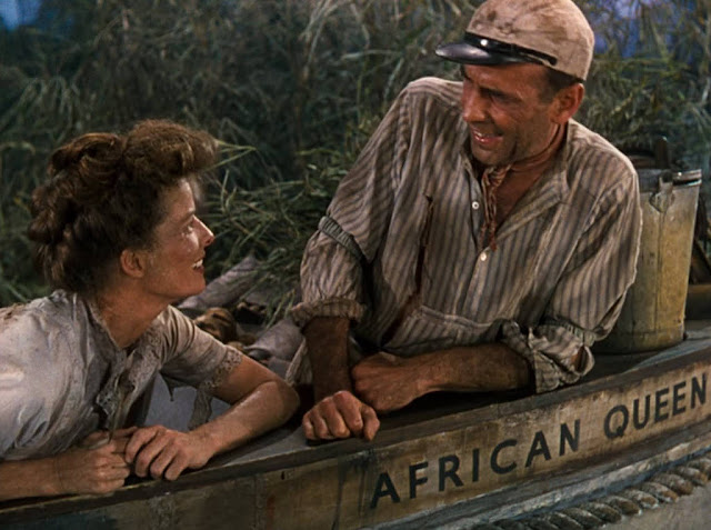 Katharine Hepburn and Humphrey Bogart on The African Queen boat