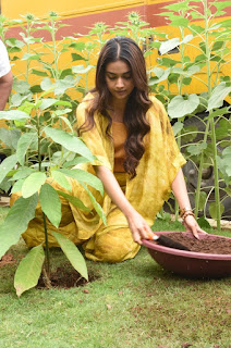 Keerthy Suresh in Yellow Dress with Cute and Awesome Lovely Smile While Planting a Plant 2