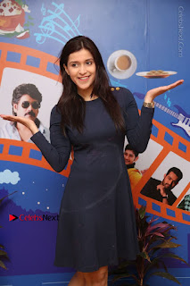 Actress Mannara Chopra Stills in Blue Short Dress at Rogue Song Launch at Radio City 91.1 FM  0037.jpg