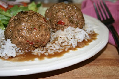 Cajun Beef Boulettes, a well seasoned beef and pork meatball, simmered in a roux based gravy, usually include a little surprise of garlic, button mushroom or even an olive tucked up inside.