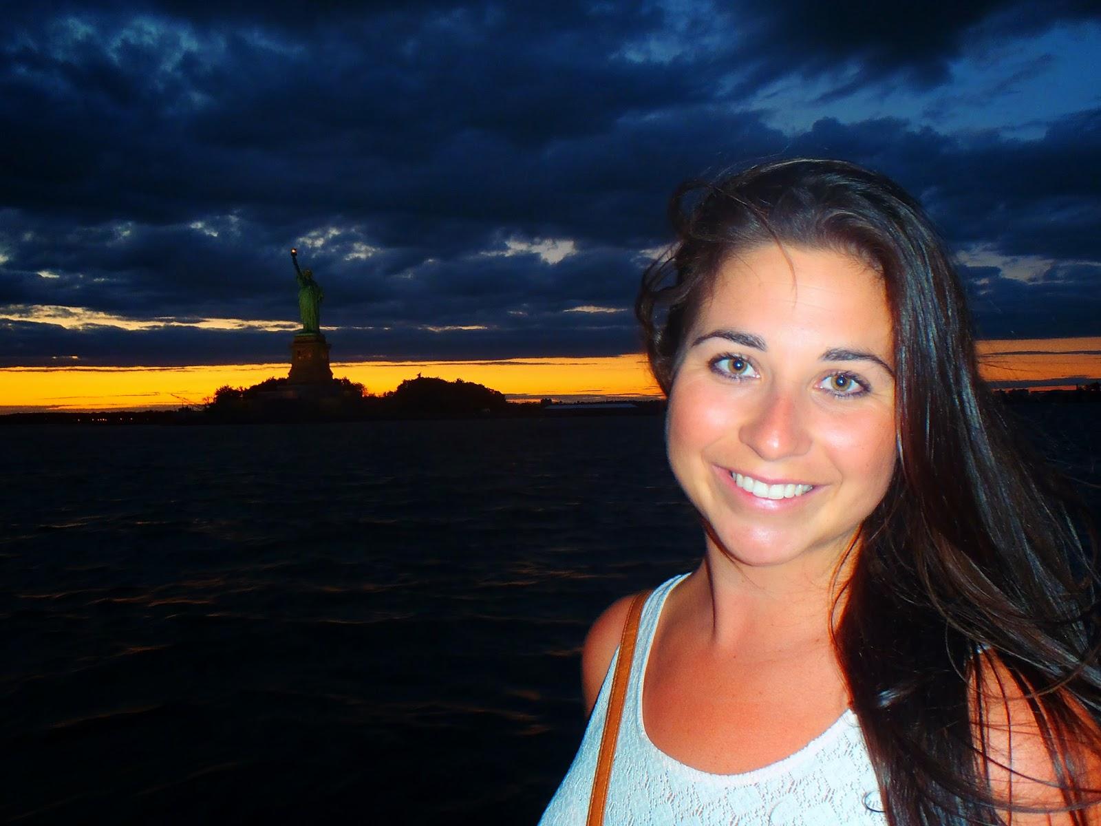Girl at Statue of Liberty at night