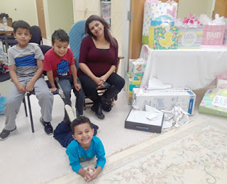 Samantha and her three boys at her recent baby shower, hosted by Abundant Hope PRC in Attleboro, Mass.