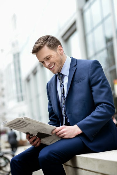 Man Reading a Press Release