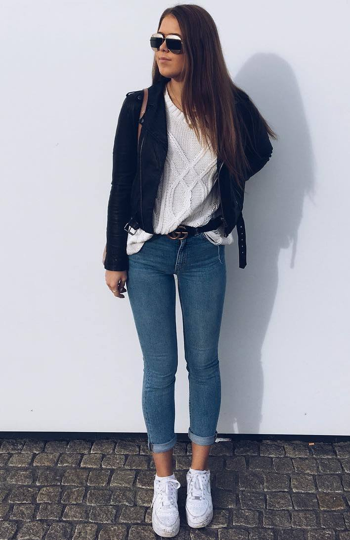 spring outfit with skinny jeans : white sneakers + knit sweater + biker jacket
