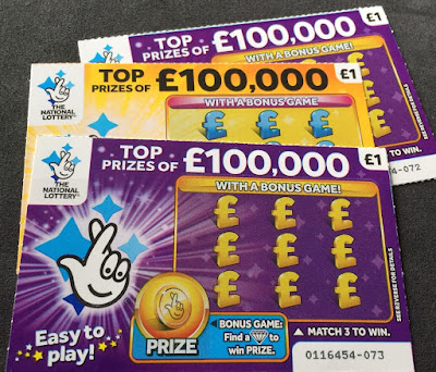 Purple and Yellow National Lottery Scratch Cards