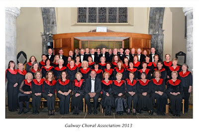 photo of the choir in 2013 before a concert in St Nicholas Collegiate church - with red scarves