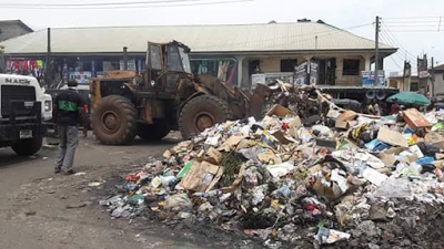 PDP in Imo State Clears refuse dump 'deliberately abandoned' by Rochas to punish residents