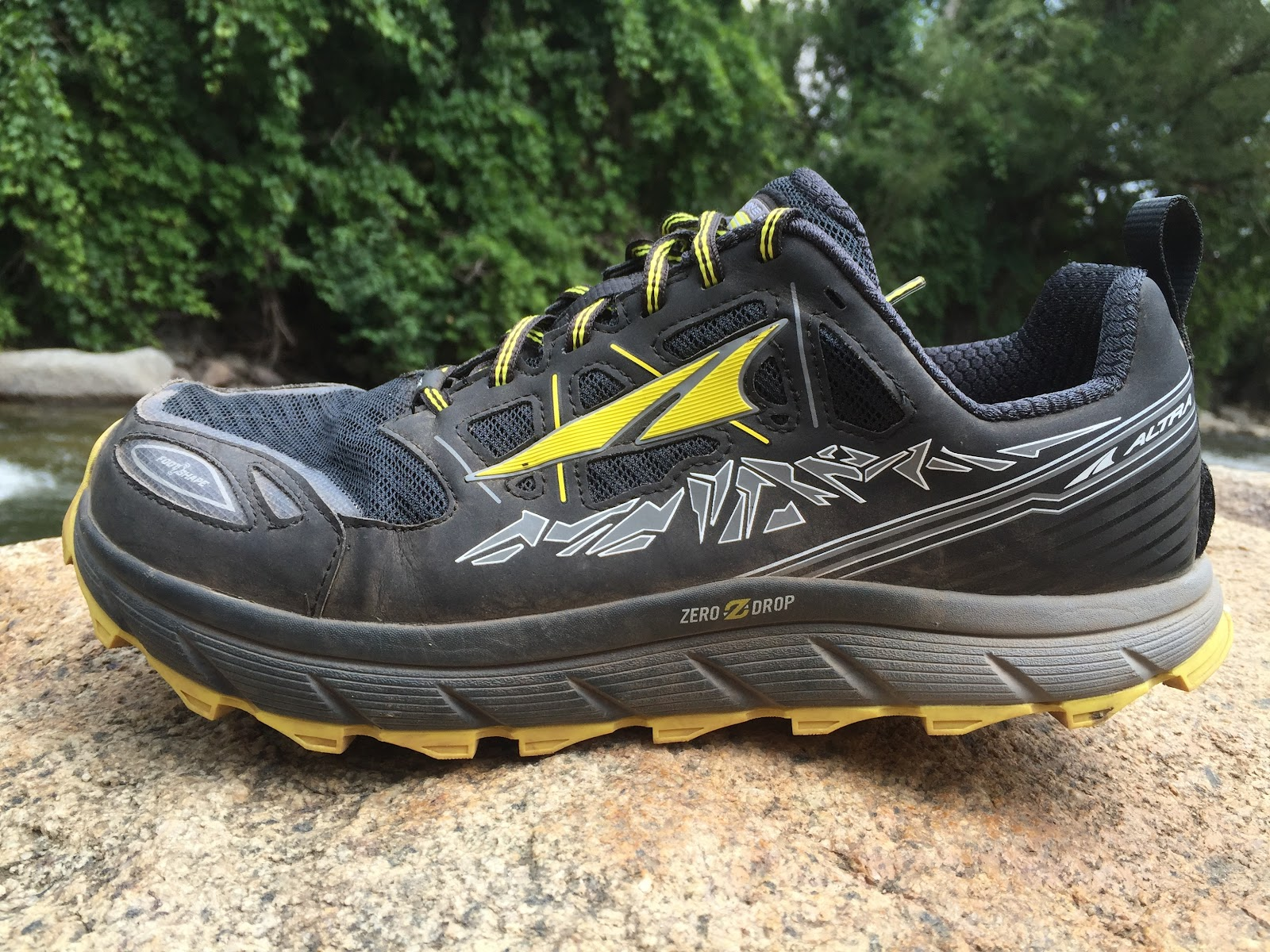The Altra Running Lone Peak 30 is a relatively light weight zero drop  moderately aggressively lugged trail runner Its upper is considerably more
