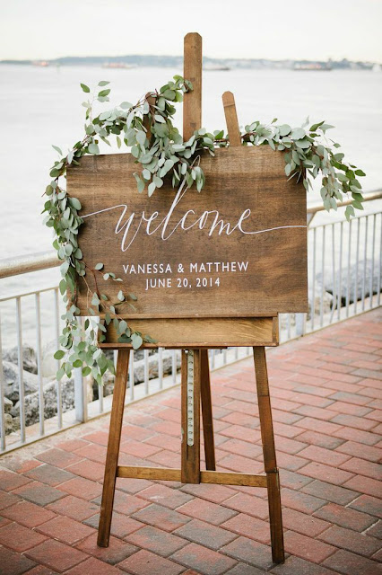wedding sign wrapped in eucalyptus