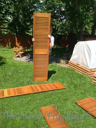 Removing the hinges from old louvered doors to use for garden screens
