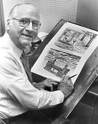 b&w photo of Charles Brooks holding one of his political cartoons