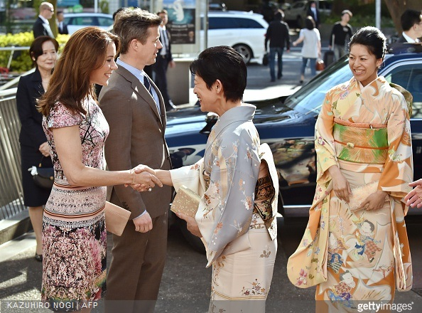 Danish Crown princess Mary and Crown Prince Frederik greet Japanese Princess Takamado and her daughter Princess Tsuguko (R) at the official opening of the exhibition about Greenland, 'Spiritual Greenland' in Tokyo
