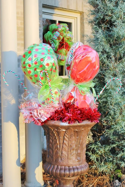The candy canes in the urns came from the Dollar Tree. & Make Big Candy Decorations | Miss Kopy Kat