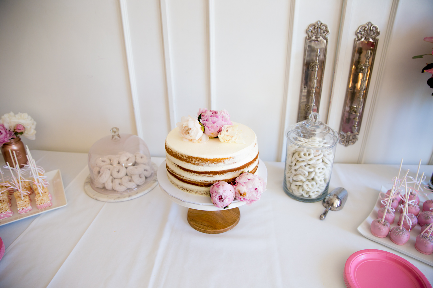 pink and white baby shower dessert table