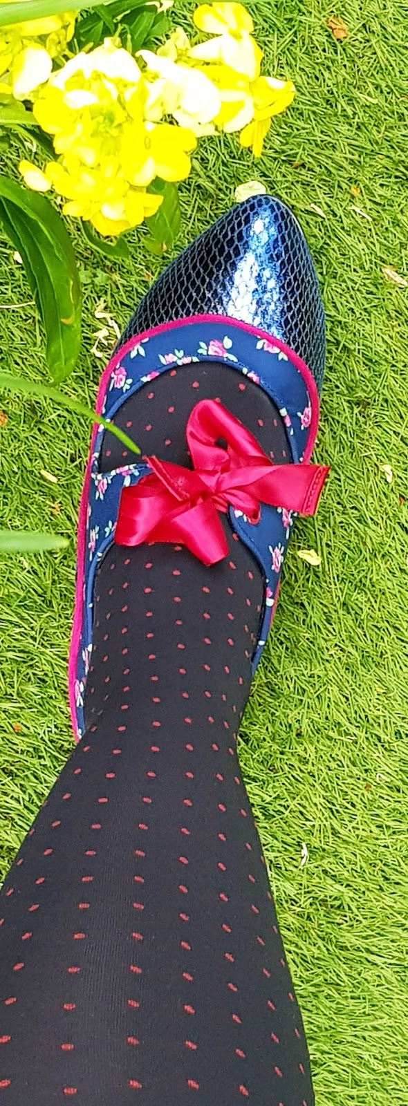 Close up showing funky blue and pink patterned shoes by Poetic Licence worn with navy and pink spotted tights. From Is This Mutton?