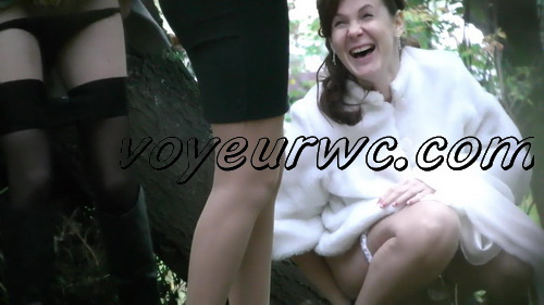 A bride in her wedding dress pissing outdoors with a spy cam observing (Wedding Pissing Park 10)
