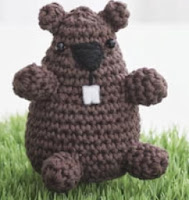http://www.yarnspirations.com/assets/files/pattern-files/pdf/Lily_SugarnCreamweb47_cr_groundhog.en_US.pdf