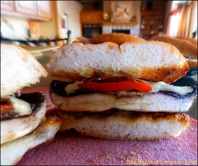 Grilled Marinated Portobello Sandwich, a large portobello mushroom and red pepper marinated for a short time, grilled and served as a sandwich. Perfect for lunch or for dinner | Recipe developed by www.BakingInATornado.com | #recipe #sandwich
