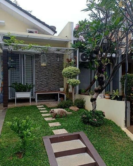 Model Teras Depan Rumah Minimalis Dengan Taman Bungan Terbaru 2019