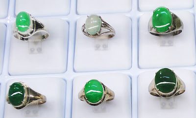 green jadeite cabochon rings in silver and gold settings