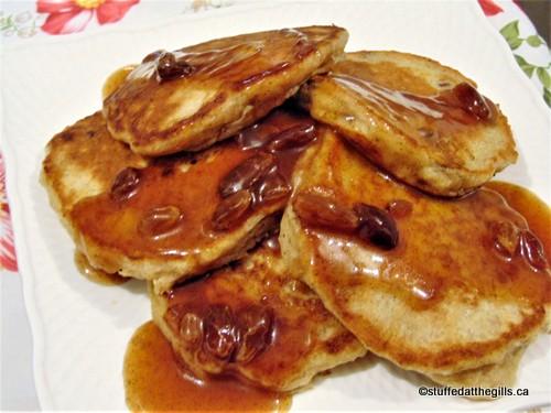 Raisin Cinnamon Sauce for Pancakes poured over pancakes.