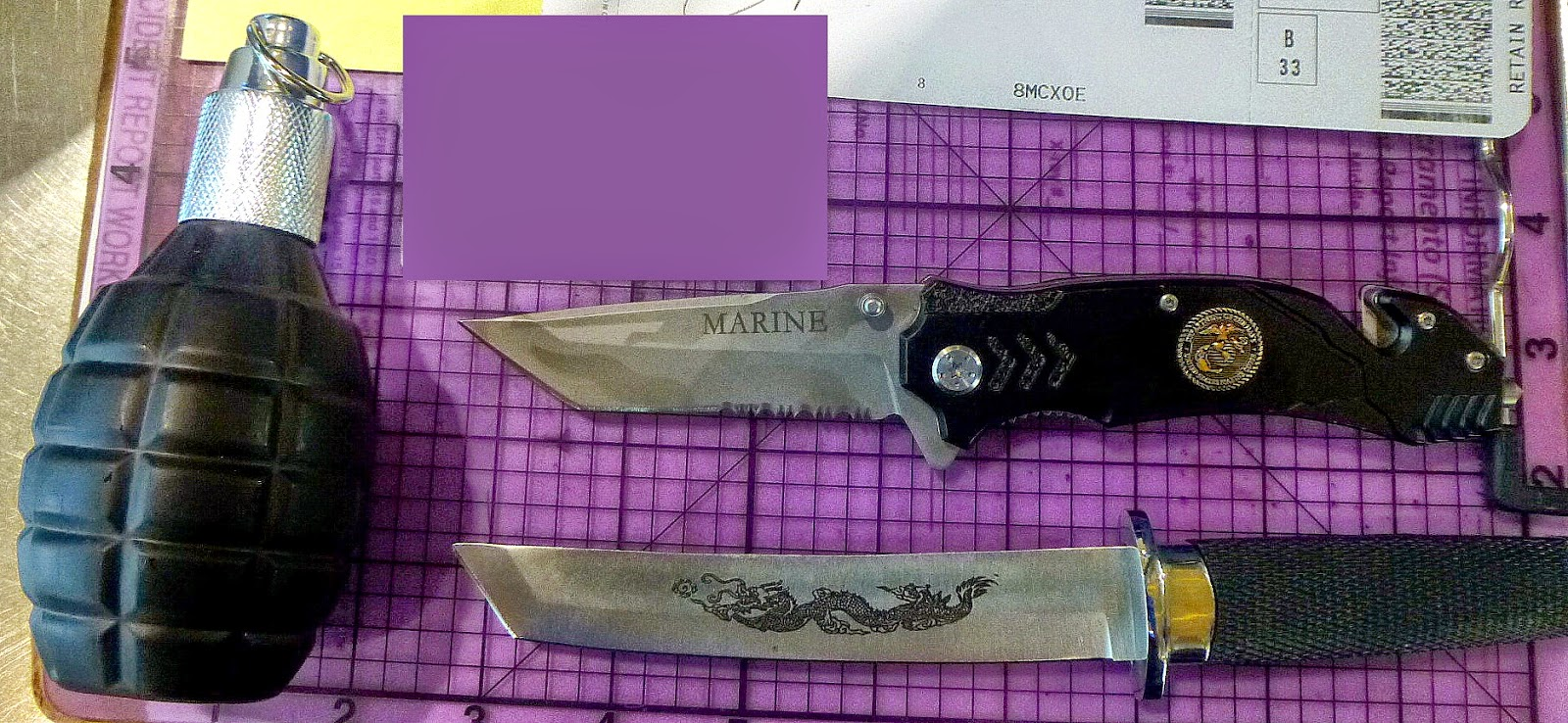 Knives & grenade-shaped cologne discovered in passenger's bag at SMF