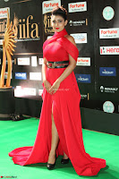 Apoorva in a Stunning Tight Leg Split Sleeveless Red Gown at IIFA Utsavam Awards 59.JPG