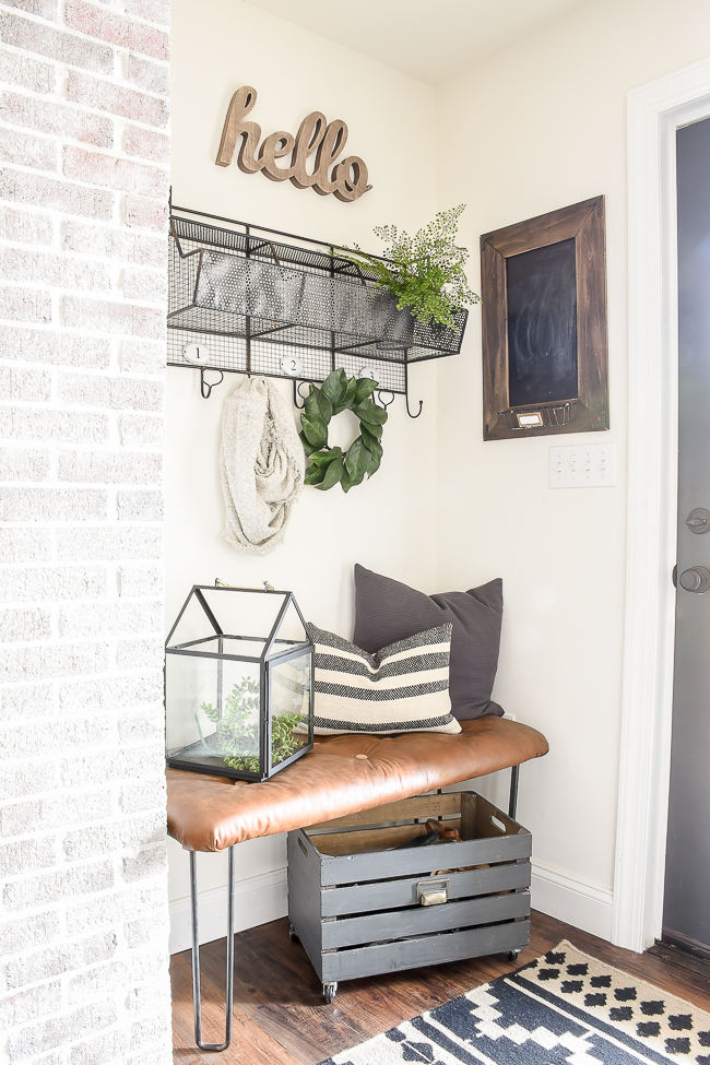 Styling throw pillows on a mudroom bench