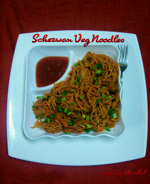 This spicy Schezwan veg noodles are made with red chilly paste and tossed with fresh vegetables. The red chilly paste adds colour to the noodles and finely chopped ginger, finely chopped garlics and finely chopped celeries add flavor to the noodles. The other ingredients are regular sauces, pepper powder and finally garnished with beautiful spring onion leaves. Without spring onions and celery you can't get the authentic  flavor. The preparation work is little bit tough, but the cooking time is very quick. For this noodles I have used the Kashmiri red chilly for the red paste. I have added some chopped garlics while grinding the red paste. The best thing is after tossing the noodles serve it immediately so that you can enjoy the hot and spicy noodles