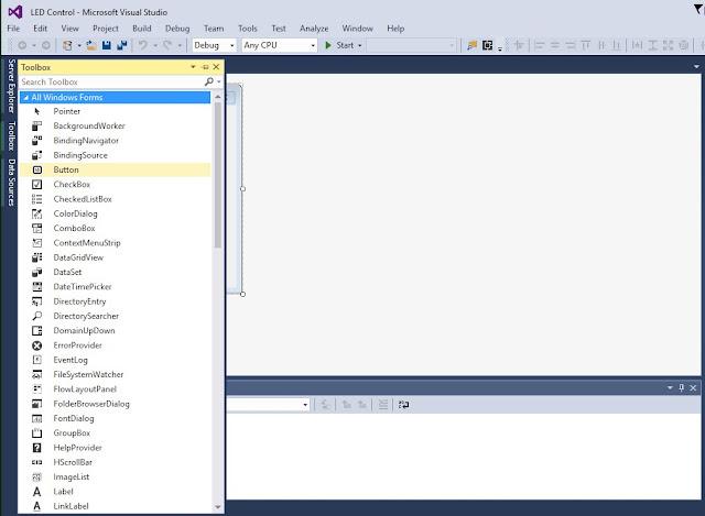 tool box में से button को drag करके window form application में drop करें