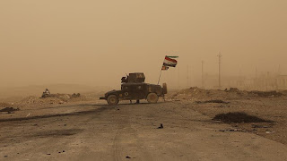 Iraqi forces battle to seize the northern city of Tal Afar