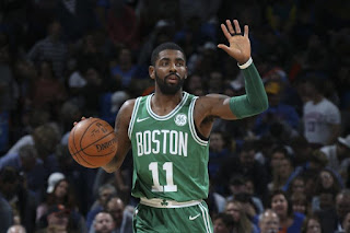 Kyrie Irving holding ball