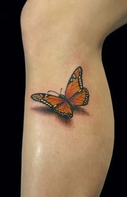 So real 3D butterfly leg tattoo!