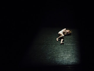 female dancer on dark stage