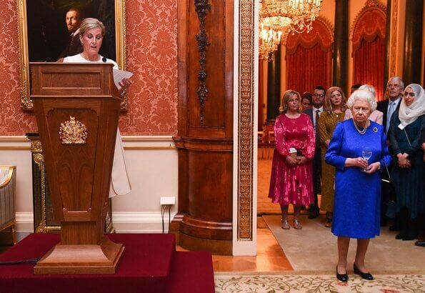 The Queen and Countess of Wessex hosted a reception. Queen wore royal blue dress. Emilia Wickstead skirt, Victoria Beckham top