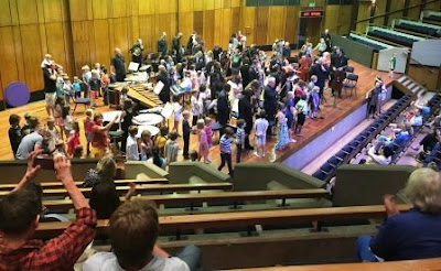 Children standing at their favourite musical instrument - Johannesburg Festival Orchestra
