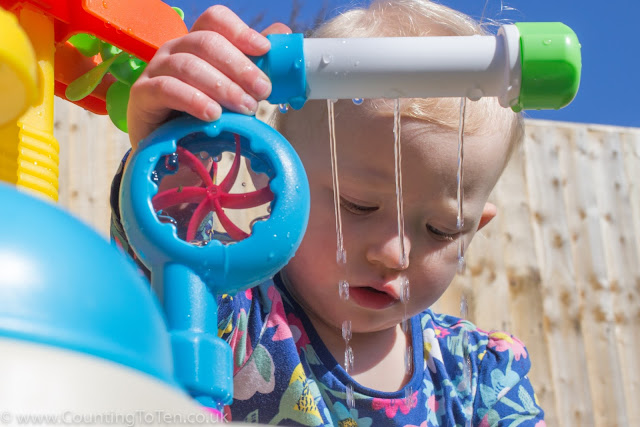 View of a toddler through sprinkler on the Little Tikes Fountain Factory Water Table