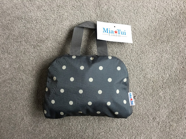 mia tui oxford backpack folded up
