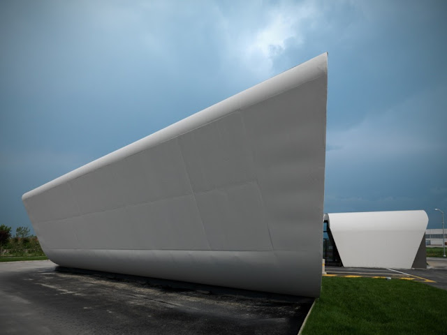 Photo of blank white facade without the windows at Gazoline Petrol Station by Damilano Studio Architects