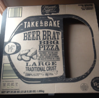 An empty box of Mama Cozzi's Beer Brat BBQ Pizza, from Aldi