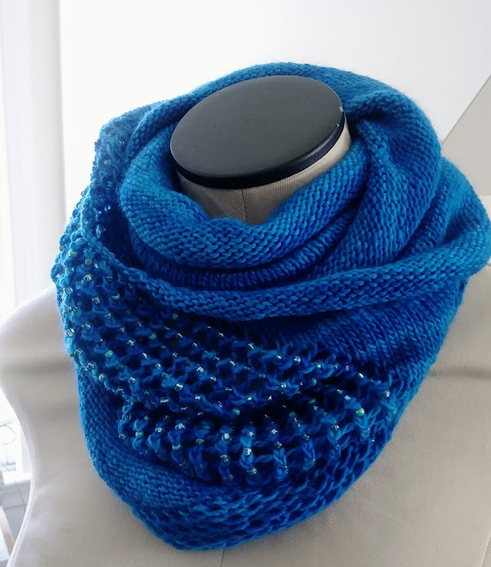 A simple, knitted beaded lace cowl.