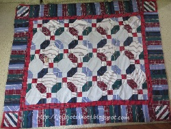 http://joysjotsshots.blogspot.com/2013/08/7-cowboy-shirt-quilt-for-sportsman-club.html
