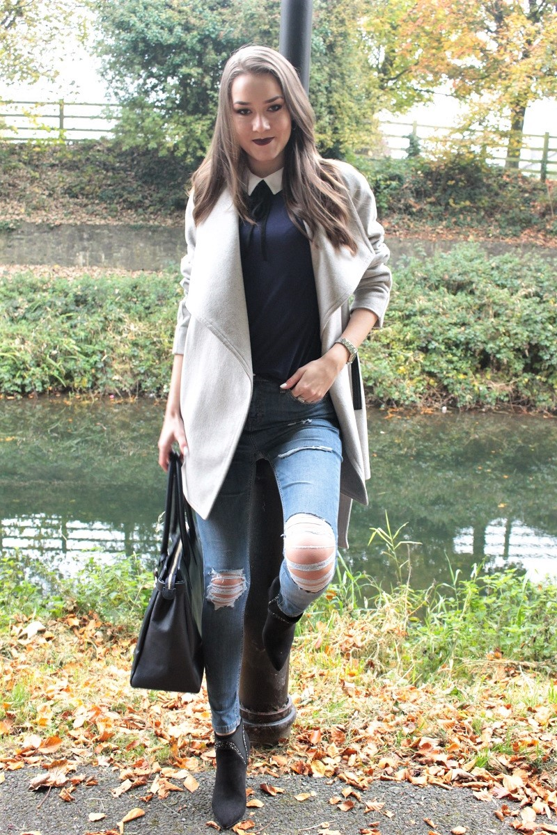 peter pan collar top, ripped jeans, waterfall coat