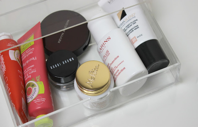 A picture of beauty products in acrylic storage