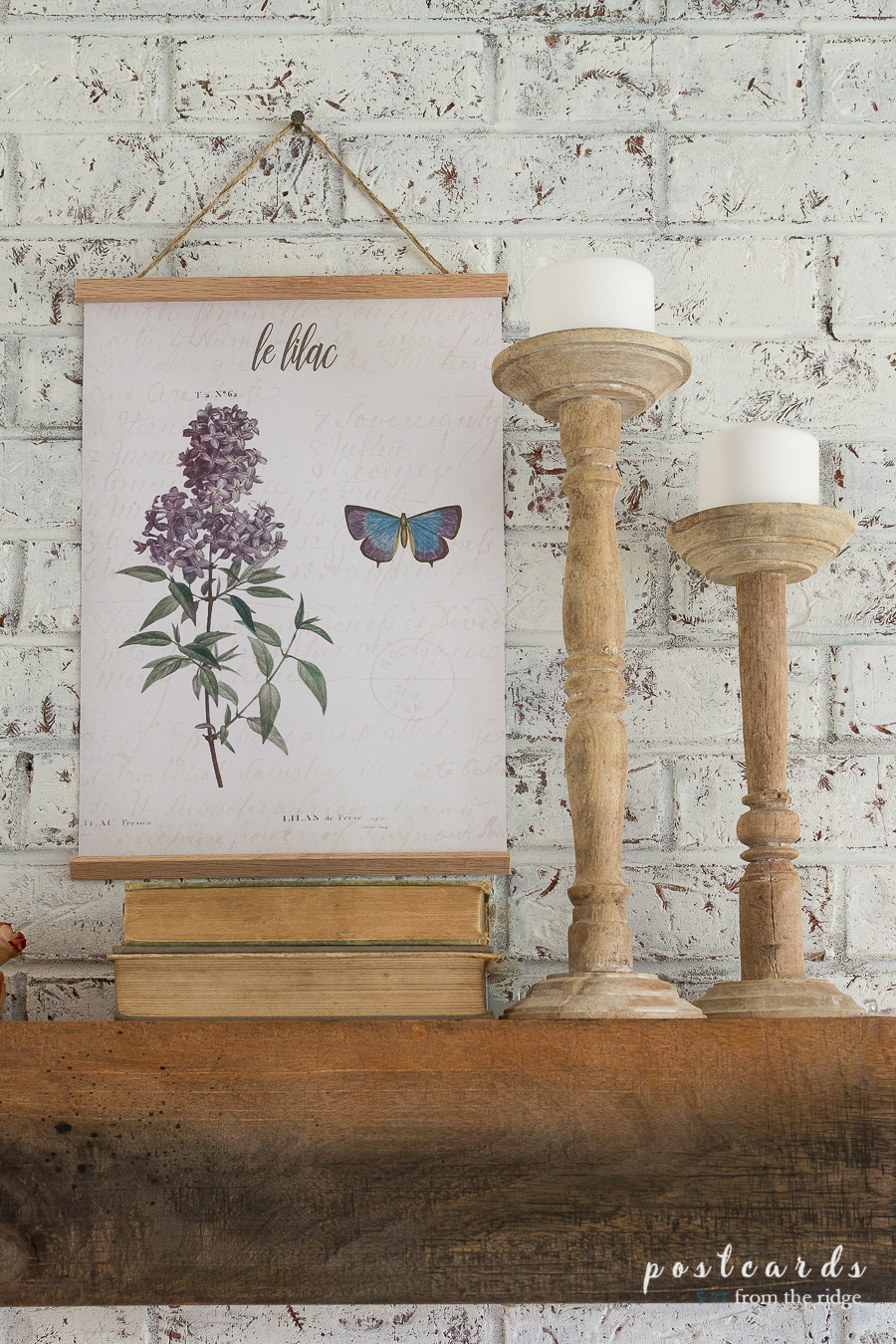 vintage book, found wooden candlesticks, and lilac botanical prints