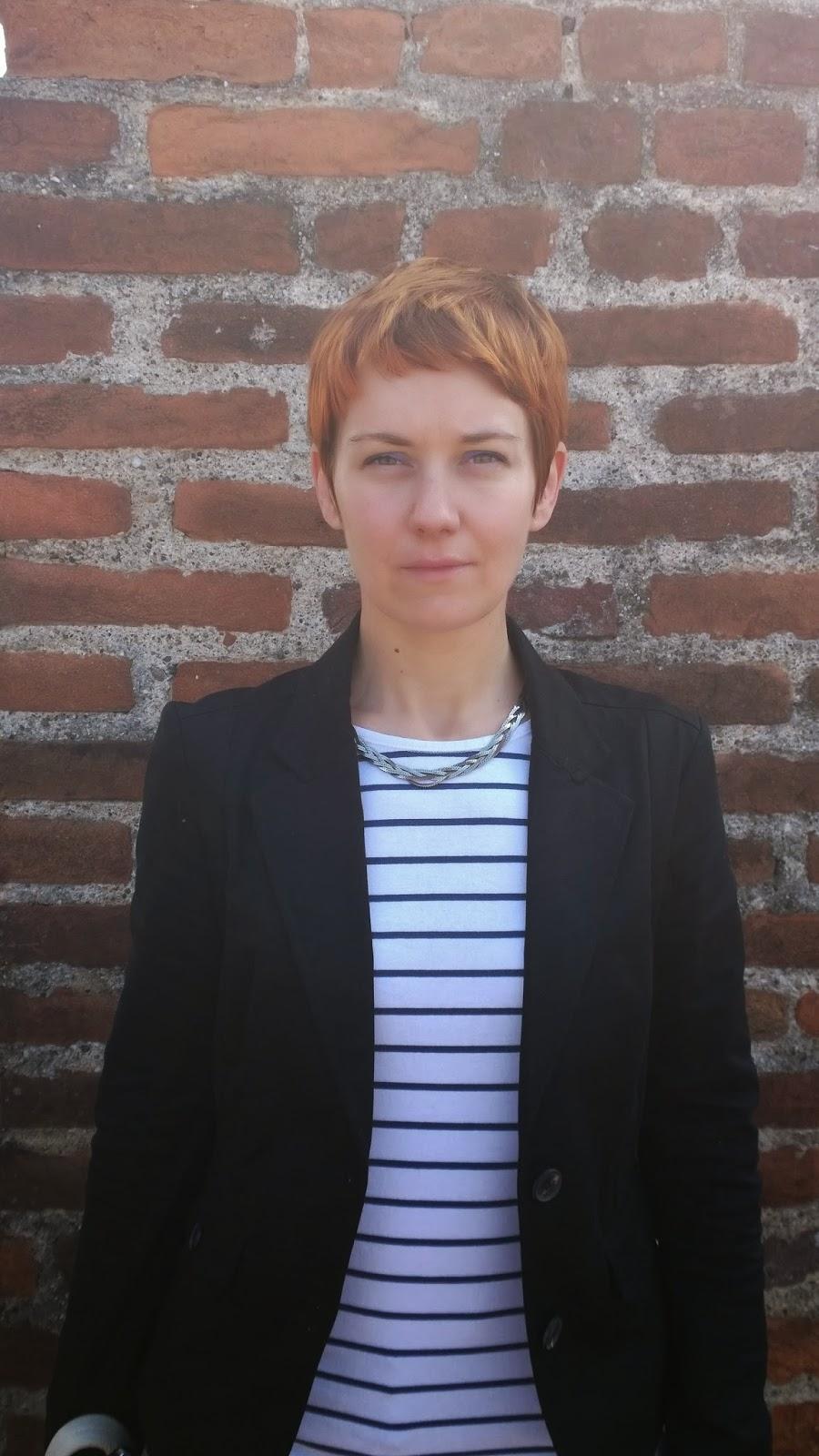 Frontal view, black blazer & striped shirt