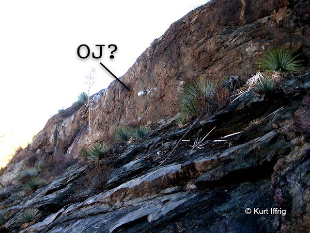 Could this read OJ? It's hard to tell. These hand painted initials are located 50 feet above the lower mine.